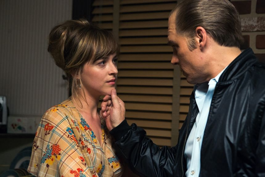 "Dakota Johnson (left, with Johnny Depp as James ""Whitey"" Bulger in Black Mass) relishes the challenge of playing the wife of the Boston mobster in the film."