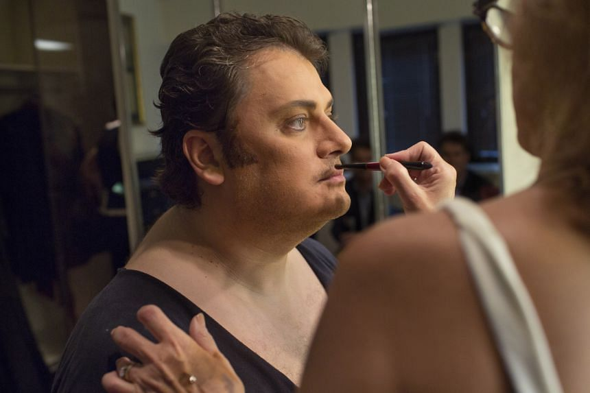 Latvian tenor Aleksandrs Antonenko being made up, but not darkened, for a production of Otello.