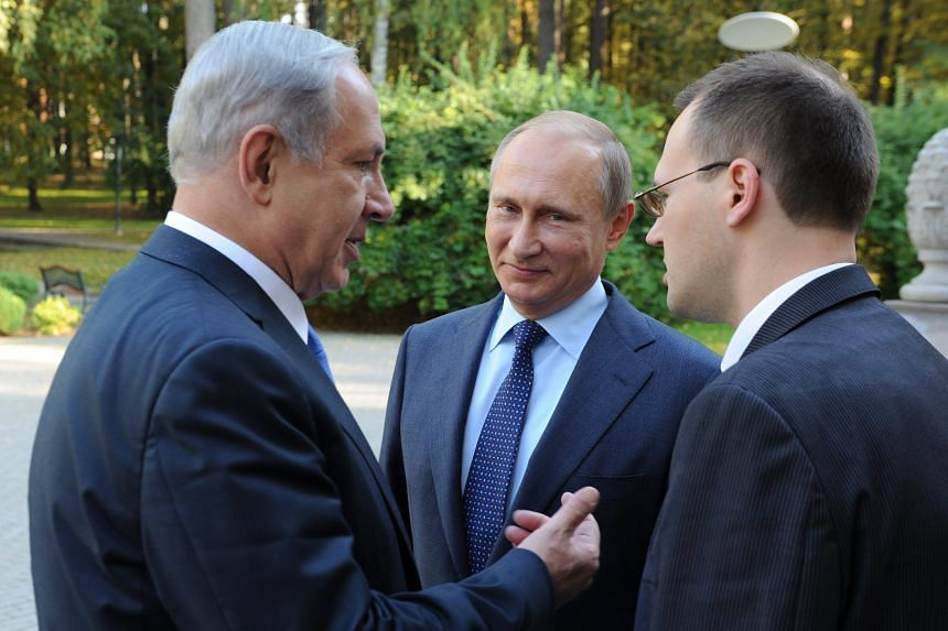 Russian President Vladimir Putin (centre) with Israeli Prime Minister Benjamin Netanyahu (left) during their meeting at the Novo-Ogaryovo residence outside Moscow on Monday.