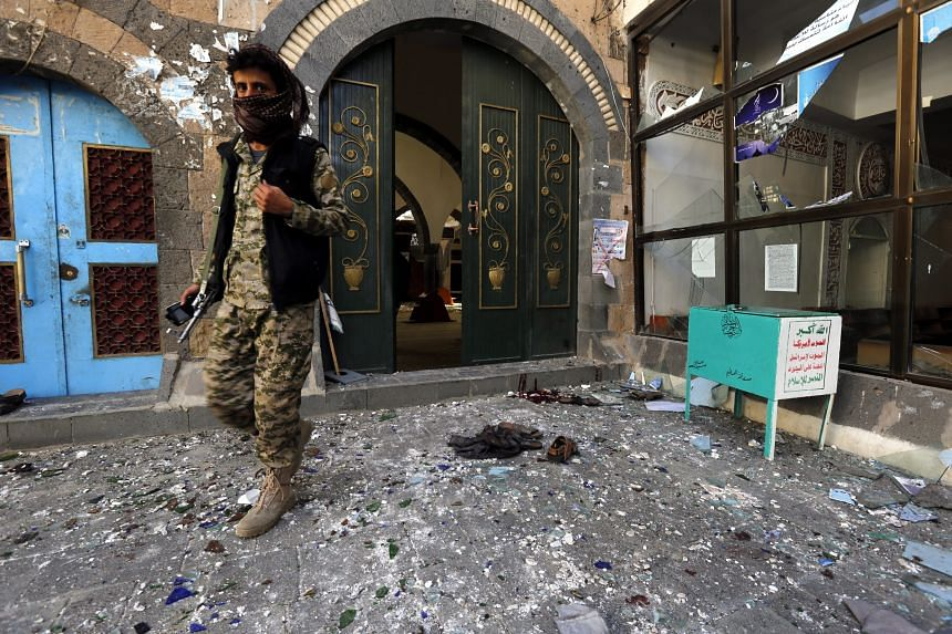 A member of the Houthi militia at the al-Balili mosque just outside Sanaa. The mosque was the target of a twin suicide bombing yesterday.