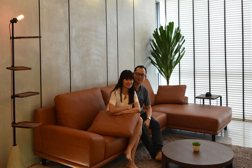 Mr Dave Siah and Ms Wendy Koh (both above) shopped overseas for accessories for their home, such as a $800 standing light (above left) from Bangkok. A six-seater wood table (left), the centrepiece in the dining room, lets the family of four lounge ar