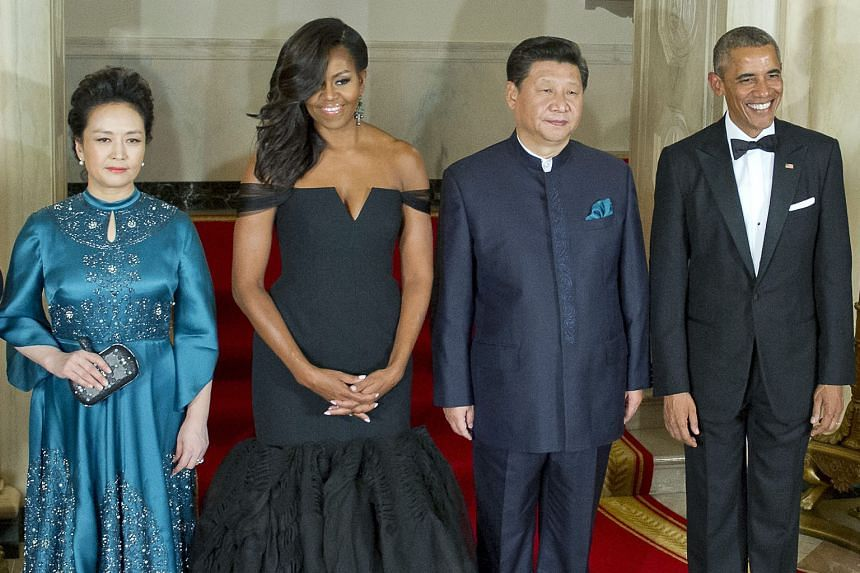 US President Barack Obama and Chinese President Xi Jinping posing for a photo at the White House on Friday with their spouses Michelle Obama and Peng Liyuan, prior to a state dinner in honour of Mr Xi's first state visit to the US capital. The Chines
