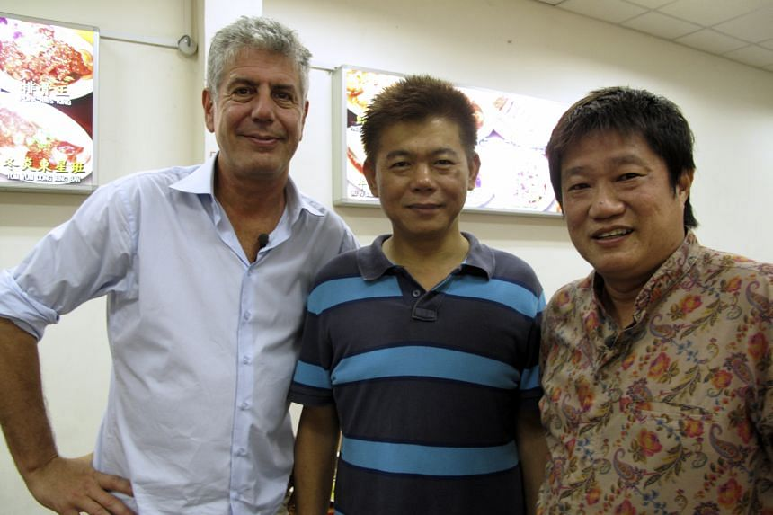 TV chef Bourdain with chef-owner Ng Kim Hock (above, middle) of Geylang Claypot Rice in Singapore and street food expert K.F. Seetoh; and an artist's impression (right) of the proposed market. Chef- entrepreneuer Anthony Bourdain (right) with one of