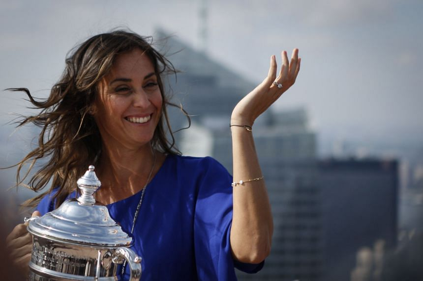 Flavia Pennetta at the Rockefeller Center's observation deck in New York City - with the US Open women's singles trophy on Sept 13. She is hoping to qualify for the WTA Finals in Singapore and end her career on a high note.