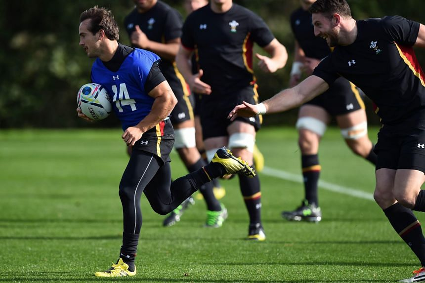 Wales' diminutive full-back Matthew Morgan (in blue vest) evading the challenge of his team-mate during a training session.