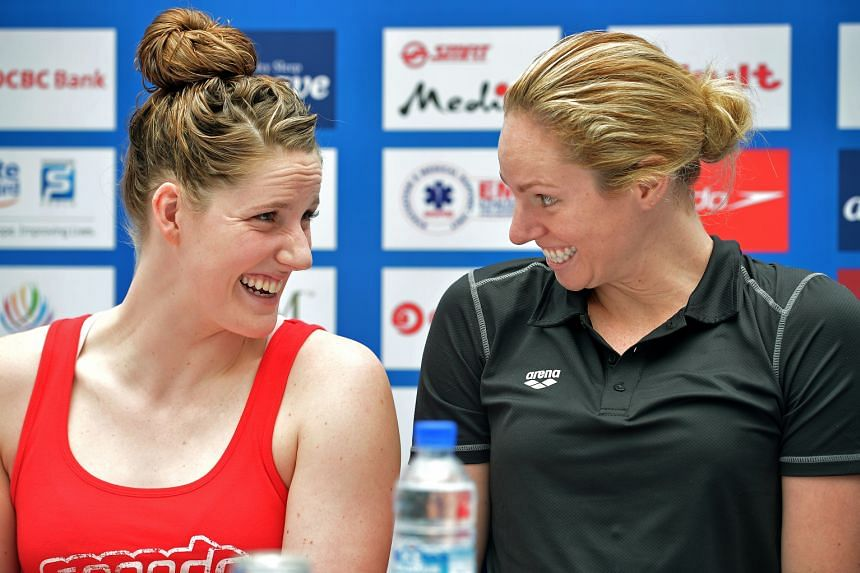 Backstroke rivals and yet good friends, American Missy Franklin (left) with Australian Emily Seebohm at the Swimming World Cup press conference at Kallang Wave Mall.