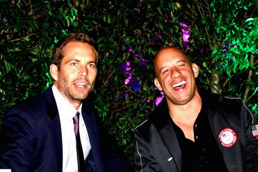 Actor Vin Diesel's (right) tribute to his Fast And Furious co-star Paul Walker (left) got a record-breaking 7.8 million likes.