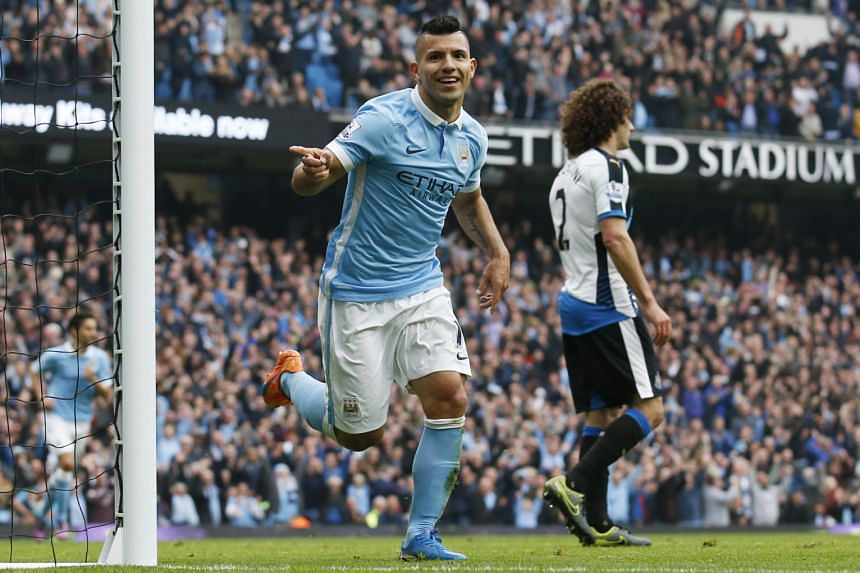 Sergio Aguero celebrating after scoring Manchester City's sixth goal against Newcastle. The win put them provisionally on top of the standings.