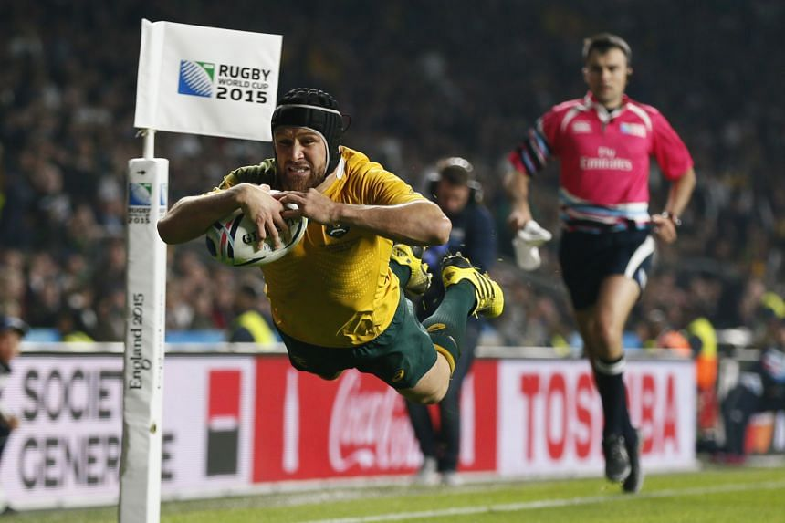Australia's Matt Giteau scoring a try against England on Saturday. The Australians showed speed and determination to knock out the hosts.
