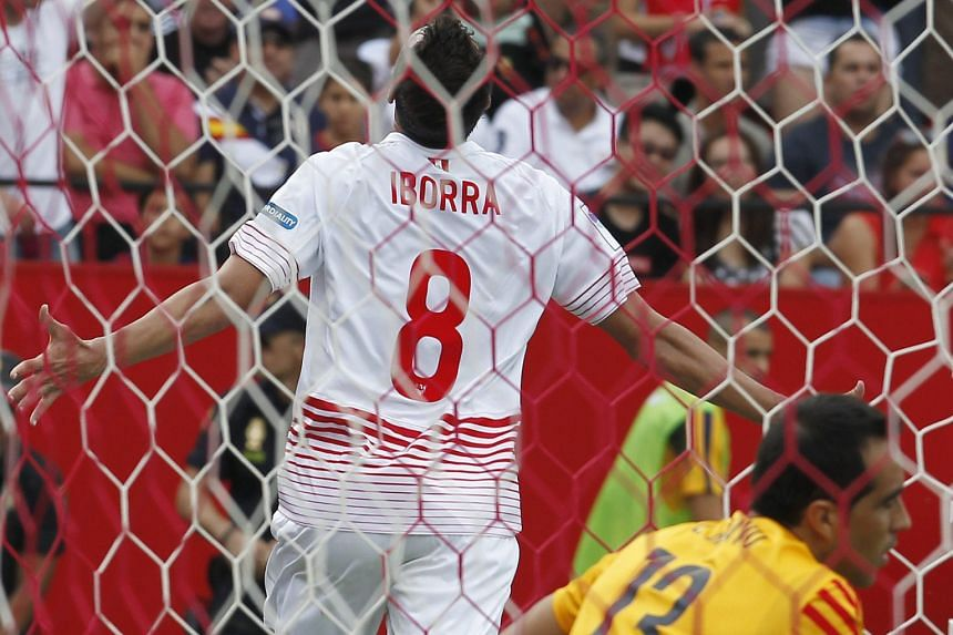 Midfielder Vicente Iborra wheeling away in delight after netting Sevilla's second goal as Barcelona goalkeeper Claudio Bravo looks away in disappointment. Sevilla took advantage of terrible defending by the visitors to win the match 2-1.