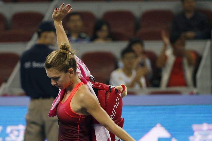 Simona Halep waving to spectators after retiring with a left-ankle injury yesterday.