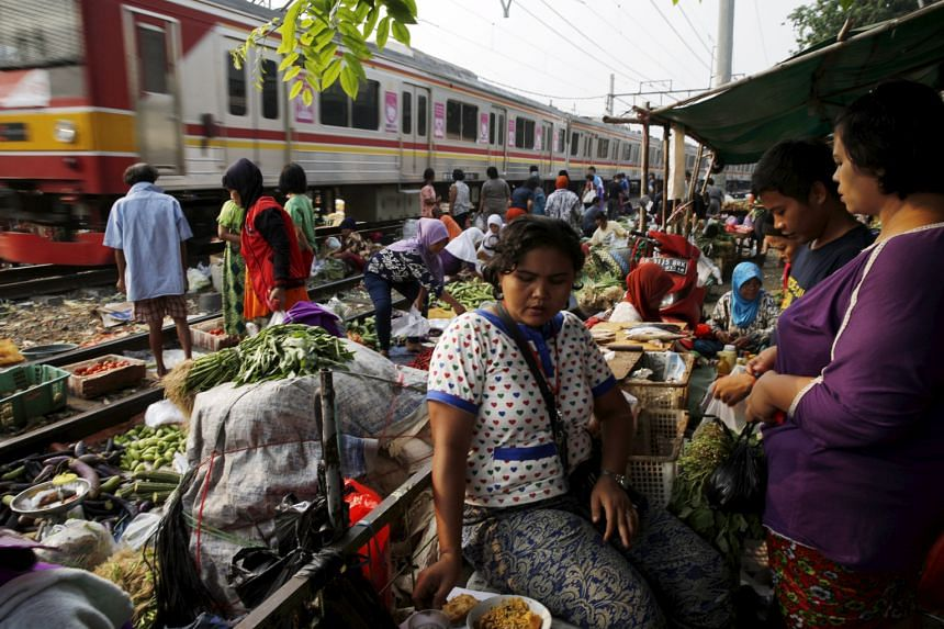 A vegetable market in Jakarta, Indonesia. A turnaround in Indonesia and Malaysia may happen as soon as next year as expansion across the world picks up, says World Bank chief economist for the East Asia and Pacific region Sudhir Shetty.
