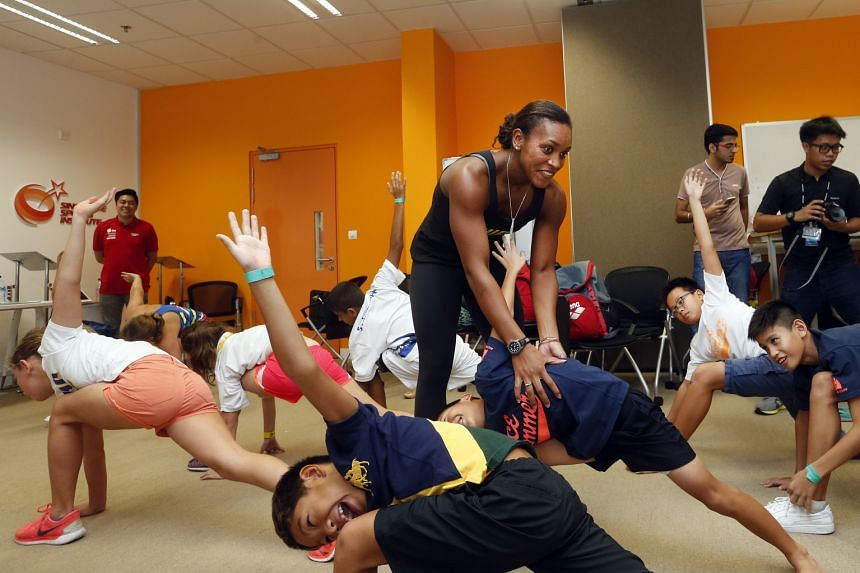 Alia Atkinson, who co-held a clinic for 30 children with Emily Seebohm, will also be happy to dispense tips when training with Singapore's national swimmers till Friday.