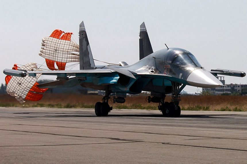 A Russian SU-34 fighter bomber landing at the Syrian Hmeymim airbase outside Latakia. Russian fighters are carrying out air strikes against what Moscow says are ISIS facilities. But Washington says more than 90 per cent of Russia's strikes target the