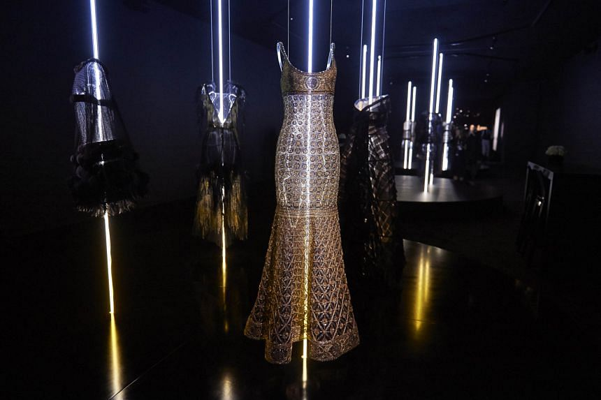 Haute-couture outfits by French fashion house Chanel on display at London's Saatchi Gallery.