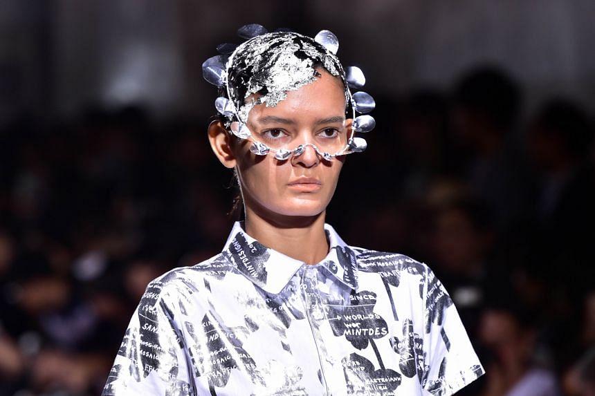 A model displays a creation by Japanese designers Hokuto Katsui and Nao Yagi during Tokyo Fashion Week.