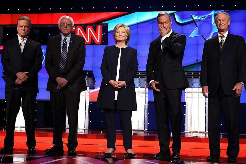 (From left) Democratic presidential candidates Jim Webb, Bernie Sanders, Hillary Clinton, Martin O'Malley and Lincoln Chafee take the stage for a presidential debate in Las Vegas on Tuesday. The five candidates were participating in the party's first