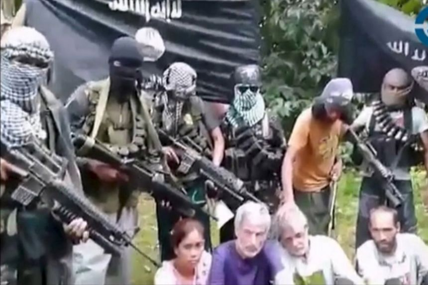 The four hostages, (from left) Ms Marites Flor, Mr Robert Hall, Mr John Ridsdel and Mr Kjartan Sekkingstad, appeared in a video on Tuesday. They were kidnapped after gunmen raided a luxury marina near Davao on Sept 21.
