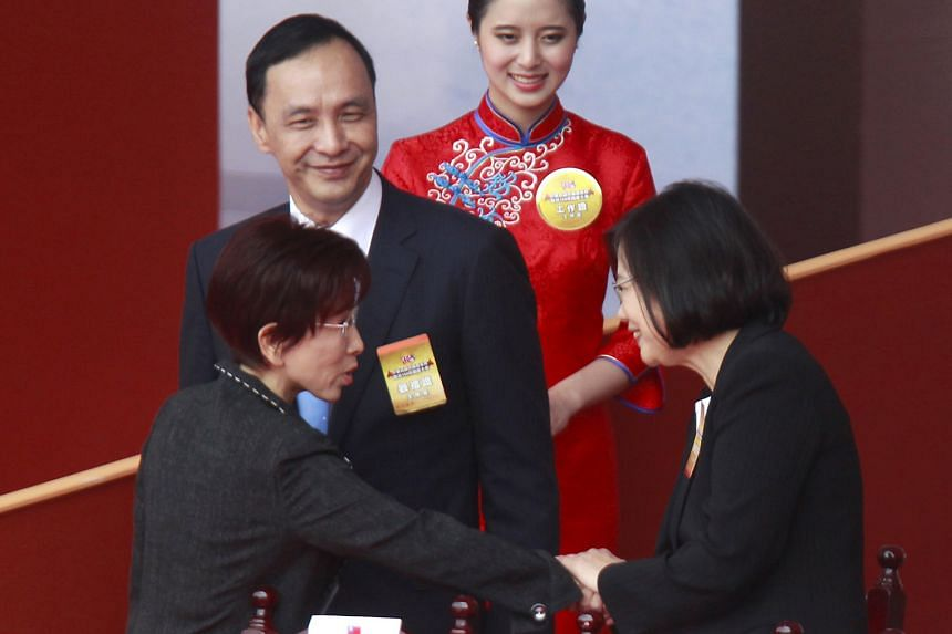 Taiwan's main opposition Democratic Progressive Party's presidential candidate Tsai Ing-wen (far right) shaking hands with the ruling Kuomintang's candidate for president Hung Hsiu-chu as KMT chairman Eric Chu looks on. The KMT is expected to lose th