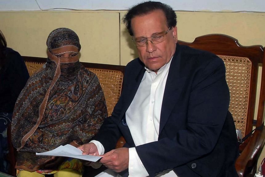 Asia Bibi (left) is shown here in 2010, the year she was sentenced to hang for blasphemy, with Pakistani Punjab governor Salman Taseer. There are fears she could be killed by vigilantes while on death row.