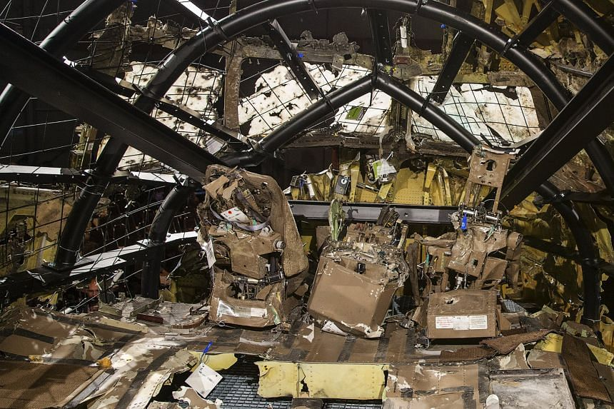 The partially reconstructed wreckage of the MH17 jet made of debris found strewn across eastern Ukraine. The Boeing 777 was hit by well over 800 high-energy objects, said the Dutch Safety Board.