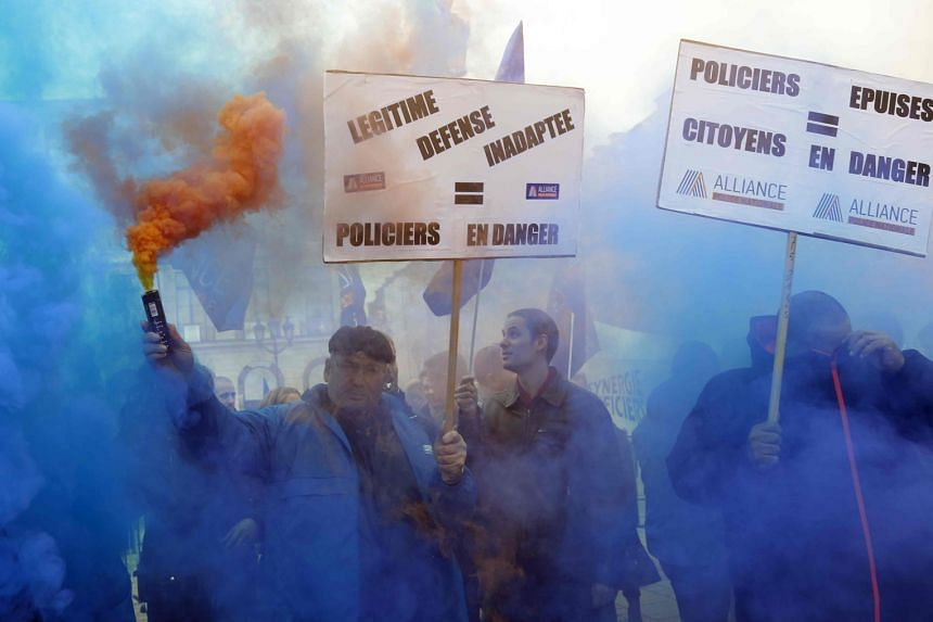 Police protesting near the Justice Ministry in Paris yesterday, for the first time since 1983. The force is stretched to breaking point as it remains on high alert for terrorist attacks while dealing with everyday crimes.