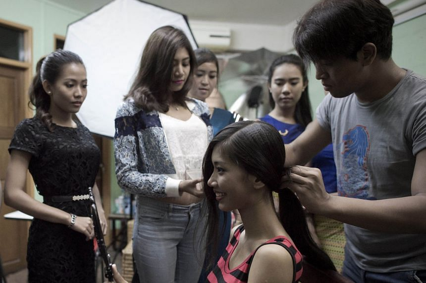 Students taking a hairstyling class at Style Plus H personal grooming school in Yangon. Such finishing schools attract students dreaming of success and celebrity in a fast-urbanising society.