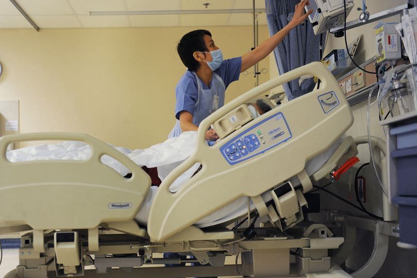 A nurse at a hospital's post-anaesthesia care unit checking the monitor which displays the vital signs of a patient who has just emerged from surgery. Under a general anaesthetic, a person should have no recall of intra-operative events.