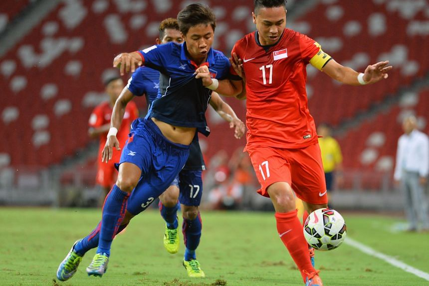 Shahril Ishak (No.17 in red) keeps Cambodia's Nen Sothearoth at bay in Singapore's 2-1 win in a World Cup qualifier at the National Stadium on Tuesday. He knows that a good performance for JDT II against the LionsXII tonight will boost his chances of