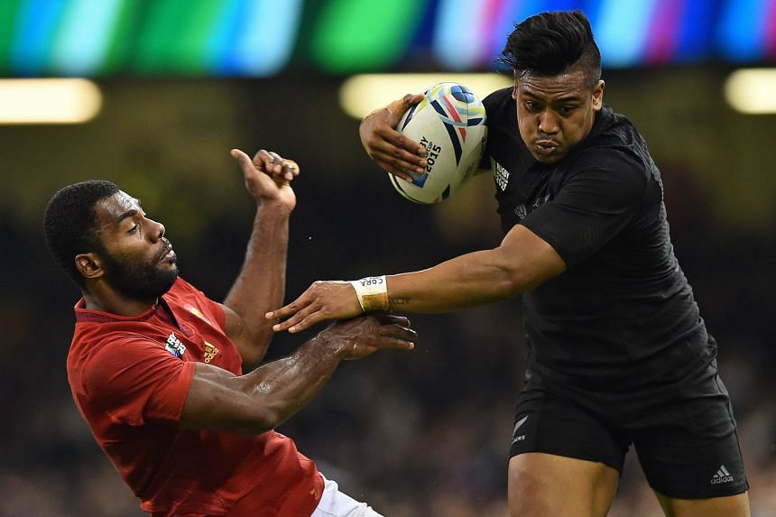 New Zealand wing Julian Savea (right) pushing aside France's Noa Nakaitaci en route to scoring his second and his team's fourth try on Saturday.