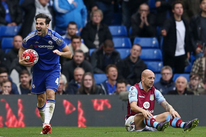 Chelsea midfielder Cesc Fabregas (left) celebrating after an own goal by Aston Villa defender Alan Hutton put the Blues 2-0 up at Stamford Bridge on Saturday. It was only the champions' third Premier League win after a horrible start to the season.