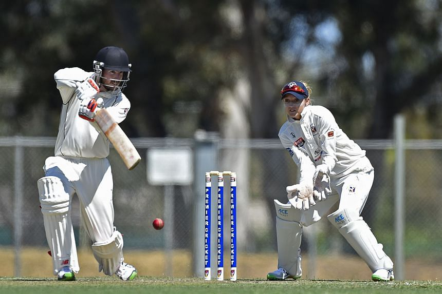 English wicket- keeper Sarah Taylor playing for Northern Districts against Port Adelaide in South Australia's premier men's cricket competition, the first woman to do so. Port Adelaide are at 227-3 after the first innings of the two-day match.
