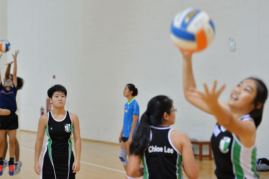 Young players learning new skills at the clinic held by Singapore's netballers at the OCBC Arena yesterday.