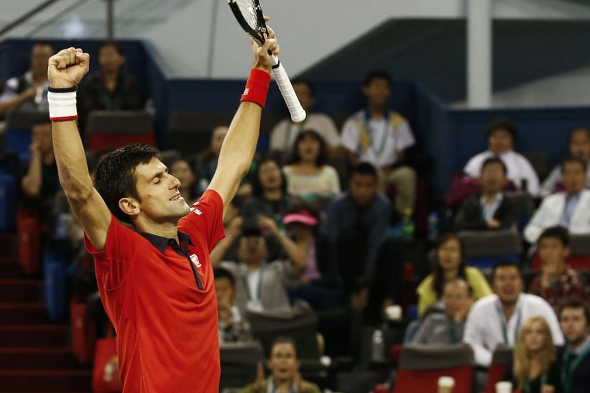 Novak Djokovic reacting after defeating Jo-Wilfried Tsonga in the Shanghai Masters final to claim his ninth title of the season, in which he also won three of the four Grand Slam finals.