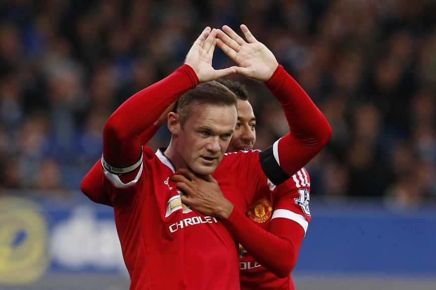 Captain Wayne Rooney getting a hug from team-mate Jesse Lingard after scoring Manchester United's third goal in their 3-0 win over Everton on Saturday. It was the English striker's first away goal in the Premier League since last November.
