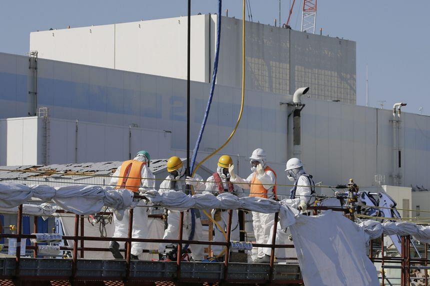 Workers setting up a barrier to prevent leakage of contaminated water at the Fukushima nuclear plant earlier this month. The latest news will likely inflame widespread public opposition to nuclear power.