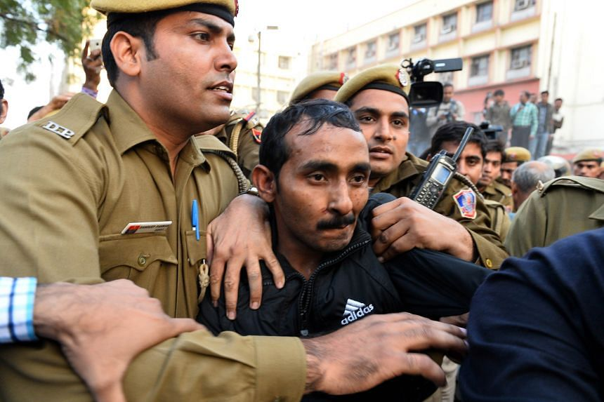 Shiv Kumar Yadav (centre) was tried by a fast-track court, which found him guilty of rape, kidnapping, assault and criminal intimidation. He faces a maximum sentence of life imprisonment.