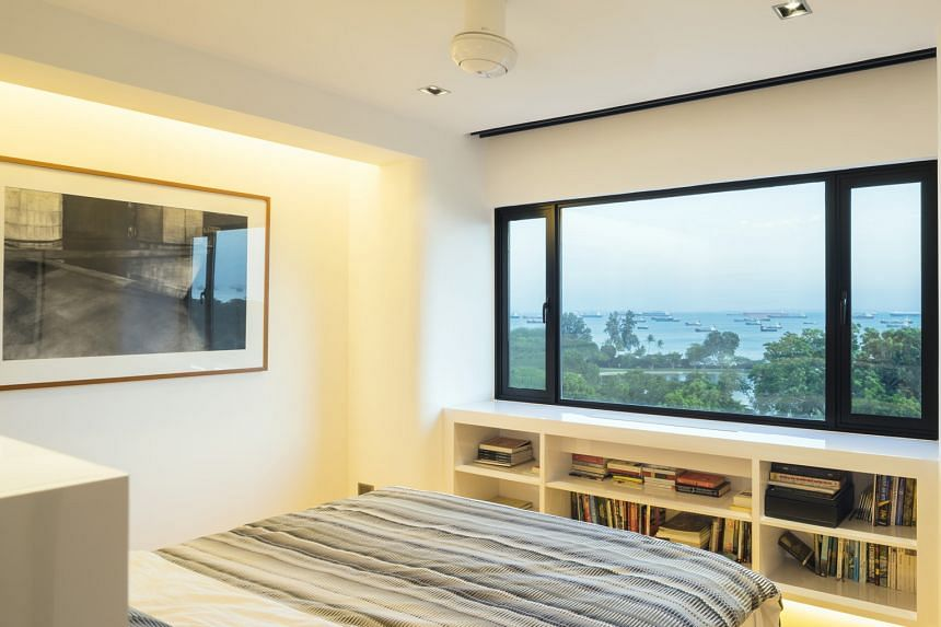 The kitchen has vintage-glazed jade ceramic tiles. The owners get a clear view of the sea from their bed. The entertaining area has a built-in walnut-and-teak shelf filled with pieces by avant-garde artists. The bathroom has two wash-basins.