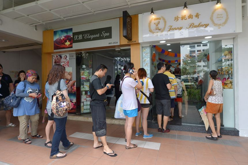 Customers eager for a taste of the famous Hong Kong cookies stood patiently in queue despite the heat and the haze.