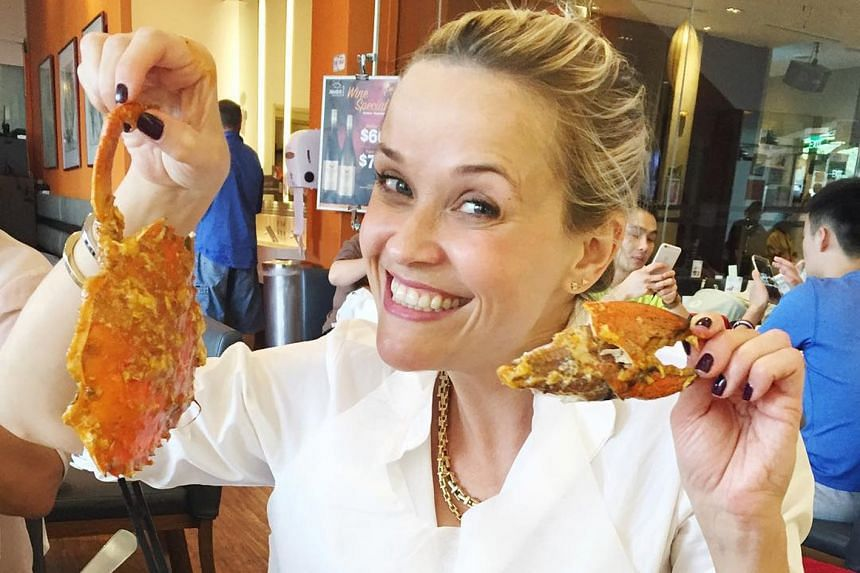 Reese Witherspoon posted photos of herself tucking into chilli crab when she was in town last week.