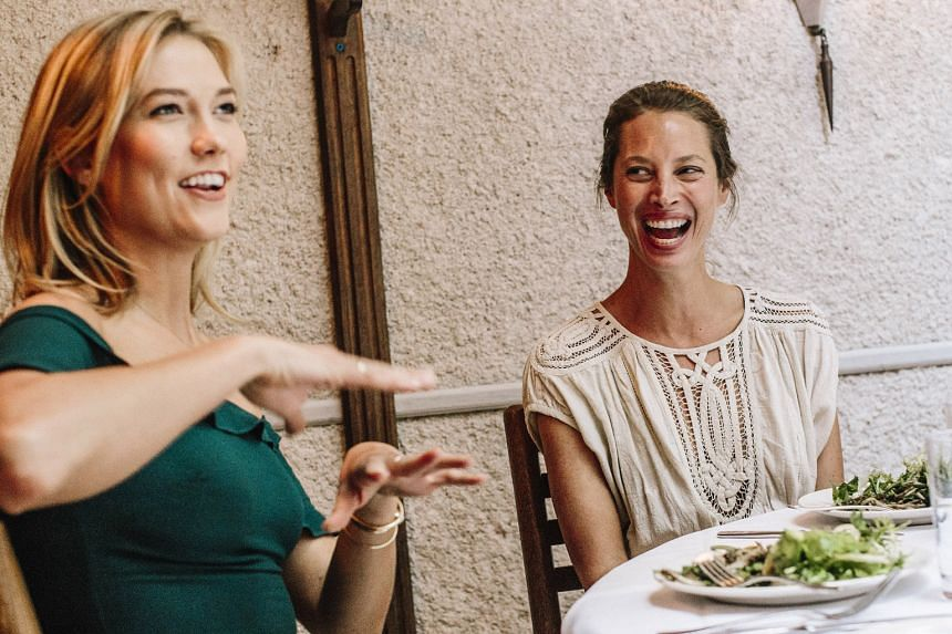 Karlie Kloss (far left) and Christy Turlington Burns (left) having lunch and hearty conversation.