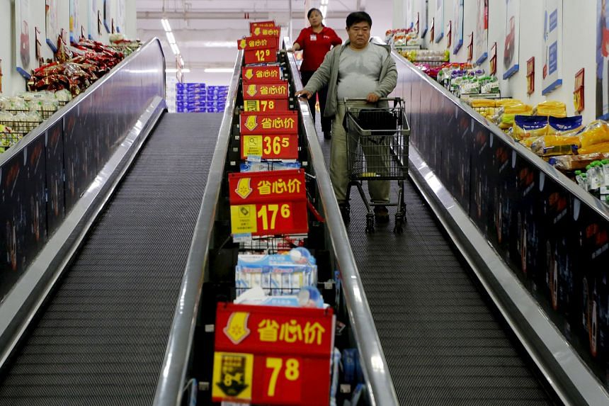 Shoppers at a supermarket in Beijing. China is aiming to double its 2010 gross domestic product and per-capita income of residents in both cities and rural areas by 2020, a goal which was first announced by former president Hu Jintao in 2012.