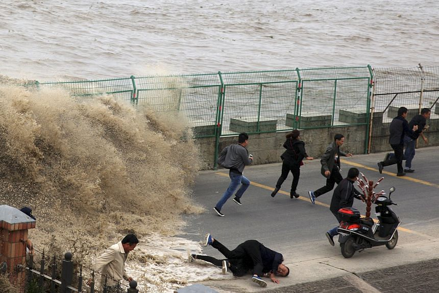 Visitors catching the spectacle of Qiantang River's annual tidal bore got more than they bargained for on Wednesday when a wave surged past a barrier on the banks of the river in Hangzhou, Zhejiang province, China, leaving some spectators injured.