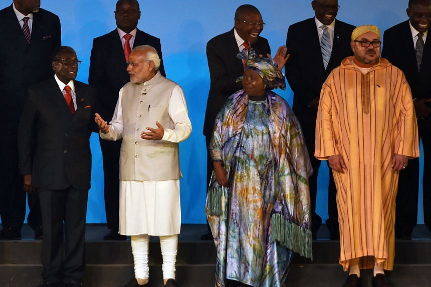 (From left) Zimbabwean President Robert Mugabe, Indian Prime Minister Narendra Modi, African Union chairman Nkosazana Dlamini-Zuma and Morocco's King Mohammed VI at the biggest India-Africa summit yesterday in New Delhi, where India is playing host t