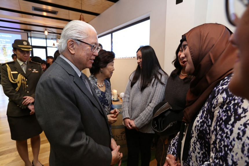 President Tony Tan Keng Yam interacting with Singapore citizens and New Zealanders born in Singapore at a reception for the Singapore community in Christchurch yesterday, during his state visit to New Zealand.
