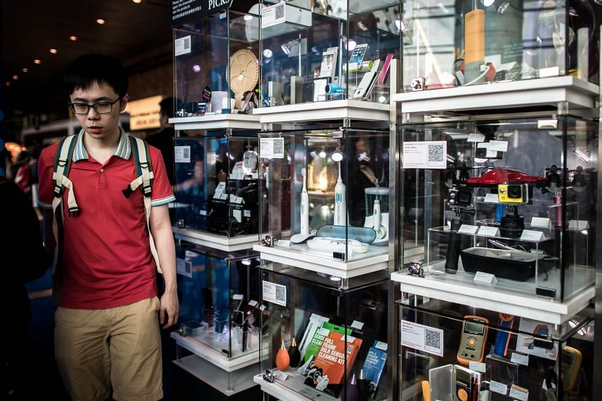 A display of electronic devices at the Hong Kong Electronics Fair in Hong Kong earlier this month. Many Asian countries see gloomy times ahead, having seen exports fall this year as compared with last year. In Singapore, nearly 40 per cent of electro