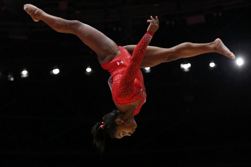 Simone Biles was not entirely perfect on the beam but her combined score - she trumped rivals on the vault and floor - was enough to claim her third consecutive world all-around crown.