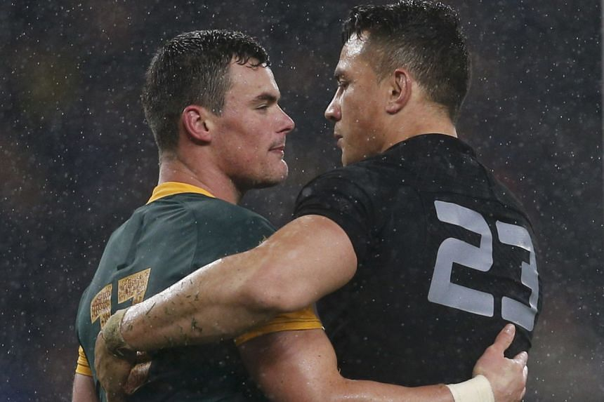 Jesse Kriel of South Africa (left) is comforted by Sonny Bill Williams of New Zealand after the All Blacks fought back to win their Rugby World Cup semi-final in London on Oct 24.
