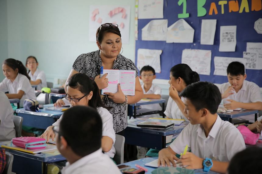 Above, Madam Rajlal conducting a contemporary literature class where students identify with the characters. Left, a student highlighting text from Kensuke's Kingdom.