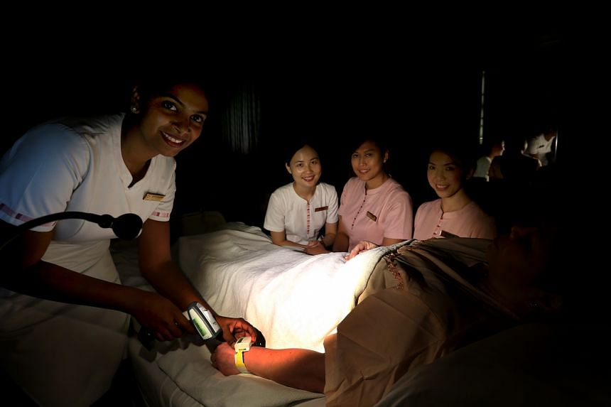 National Heart Centre Singapore nurses (from left) Abirami Nagarasan,34, Xiao Bing, 26, Siti Fidawati Jasman and Wu Wing Yin were part of a team that brainstormed for a solution to avoid disrupting other sleeping patients while they attended to one d